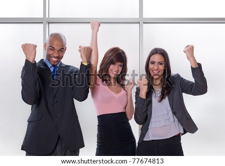 Winners. Happy and successful multicultural business team. - stock photo