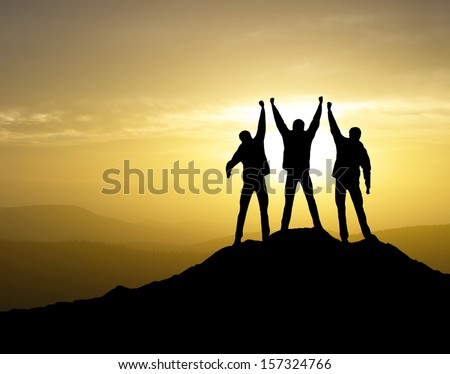 Winners team on the mountain top. Sport and active life concept - stock photo