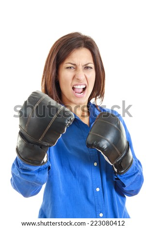 Winning business or casual woman celebrating wearing boxing gloves and business suit. Winner and business success concept photo of young  Caucasian businesswoman isolated on white background. - stock photo