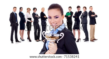 winning businessteam with female executive holding a gold trophy - stock photo