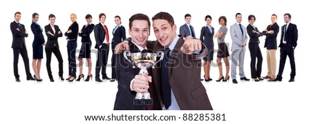 winning businessteam with two leaders, one holding a trophy, one pointing to you! - stock photo