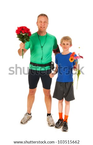 Winning father and son with flowers - stock photo