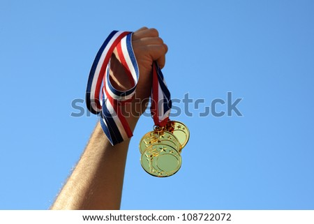 Winning gold medals - stock photo