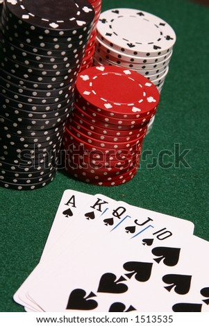 Winning poker hand of spades next to stacks of poker chips, selective focus, close up. - stock photo
