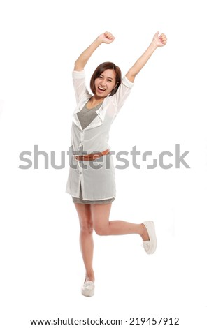 Winning success woman happy ecstatic celebrating being a winner, image of Asian female model - stock photo