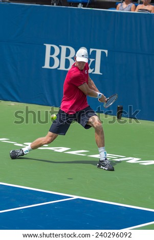 WINSTON-SALEM, NC, USA - AUGUST 19: Kevin Anderson plays on center court at the Winston-Salem Open on August 19, 2014 in Winston-Salem, NC, USA - stock photo