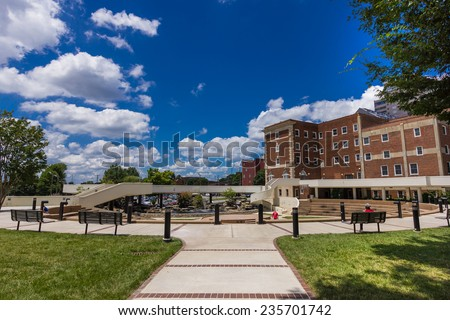WINSTON-SALEM, NC, USA - JULY 15:Workers taking a lunch break at Winston Square Park on July 15, 2013 in Winston-Salem, NC, USA - stock photo
