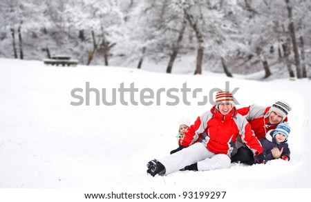 Winter activities, family in the winter forest - stock photo