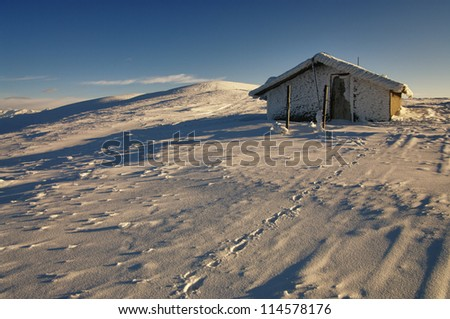 winter alpine hut - stock photo