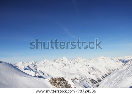 Winter alpine mountains covered with snow