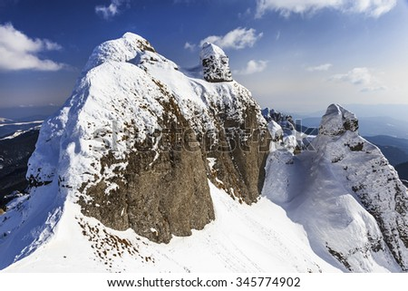 Winter alpine panorama with snow covered cliffs  - stock photo