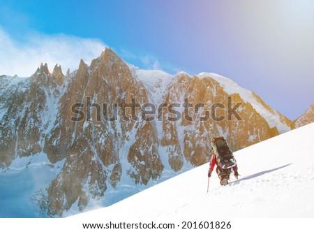 Winter alpine trekking - stock photo