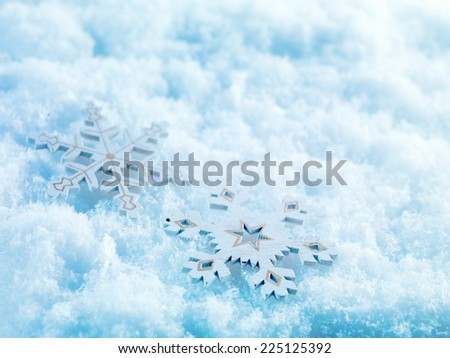 Winter and Christmas background. Two beautiful vintage snowflakes on a white snow background. Winter and Christmas concept.  - stock photo