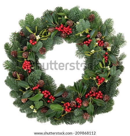 Winter and christmas floral wreath with holly, ivy, mistletoe and spruce fir over white background. - stock photo