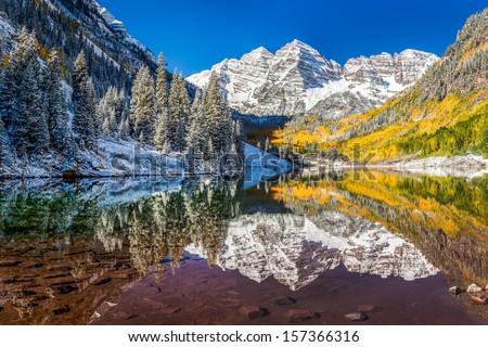 winter and fall foliage at Maroon Bells, Aspen, Colorado - stock photo