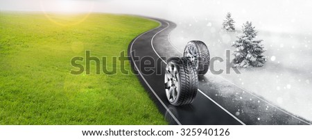 Winter and summer tires on the road - stock photo