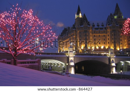 Winter at the Rideau Canal and Chateau Laurier Hotel in Ottawa - stock photo