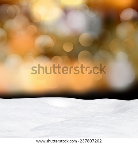 Winter background - Abstract bokeh lights and snowdrift - stock photo
