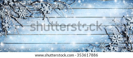 Winter Background - Snowy Branches On Plank With Snowflakes  - stock photo