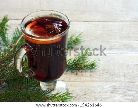 Winter background with glass of mulled wine - stock photo