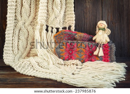 Winter  background with  handmade scarf, mittens and angel - stock photo