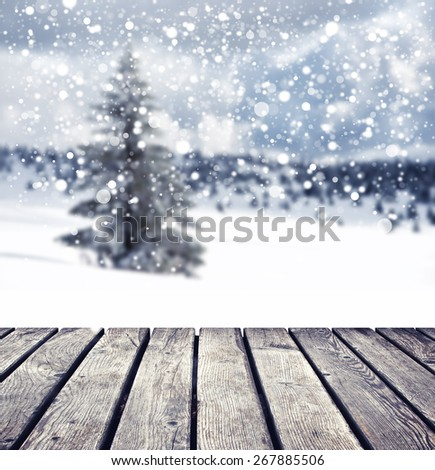 winter background with individual tree and cloudy sky with snowflakes - stock photo