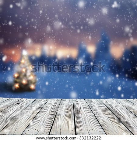Winter background with mole and blur evening landscape. Empty wooden planks on foreground. Copyspace for text - stock photo
