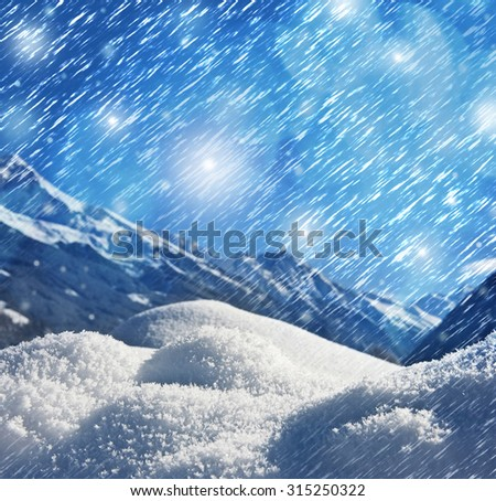 winter background with snow texture close up and mountains background - stock photo