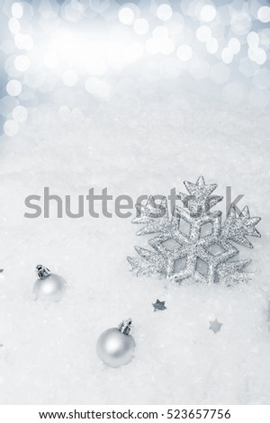 Winter background with snowflakes, Christmas decorations and highlights