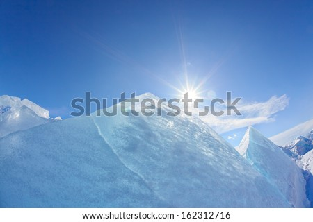 Winter Baikal lake landscape with Sun on blue sky - stock photo