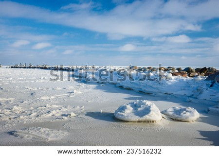 Winter Baltic sea beach, ice covered