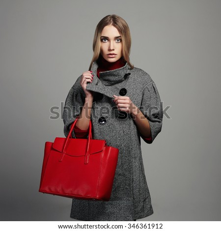 Winter beautiful Woman with Handbag.Beauty Fashion Girl in topcoat.Shopping - stock photo