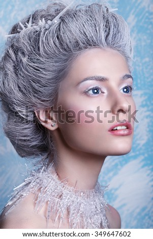 Winter Beauty Woman. Christmas Girl Makeup.Winter Queen with Snow and Ice Hairstyle - stock photo
