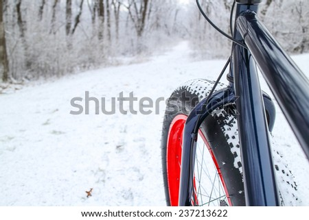 Winter biking on a Fat tire bike. Shallow focus. Focus on Bicycle Fork. - stock photo