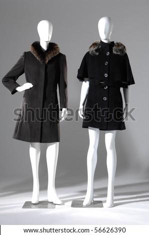 Winter black coat dress on mannequin - stock photo