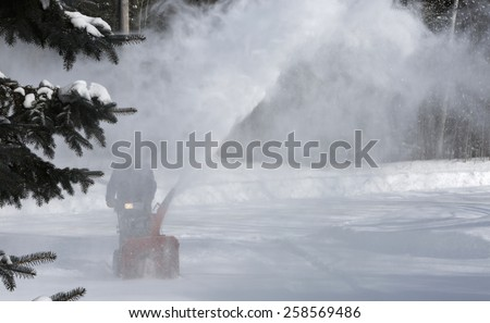 Winter blizzard: Clearing Snow with a Snow Blower - stock photo