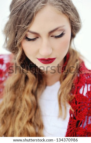Winter blonde woman portrait. Beautiful fashion model girl in bright scarf - stock photo