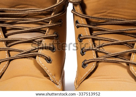 Winter boot with shoelace on white background - stock photo