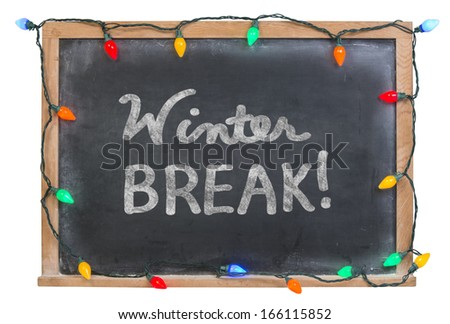 Winter Break hand drawn in white chalk on a black chalkboard surrounded by colorful holiday lights isolated on white - stock photo