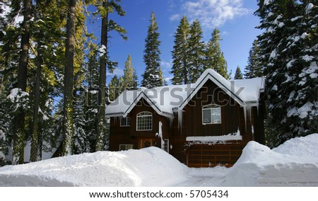 Winter Cabin covered with fresh snow - stock photo