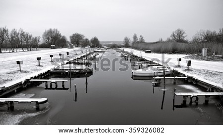 Winter canal boat harbor in black and white