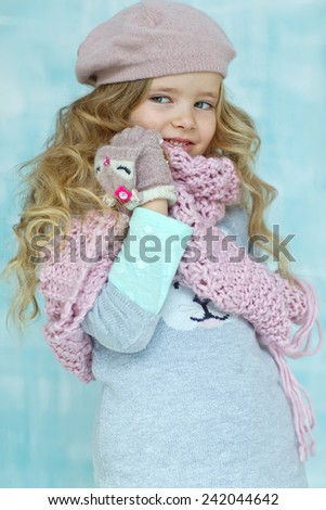 winter cap wool scarf little fashion girl portrait  - stock photo