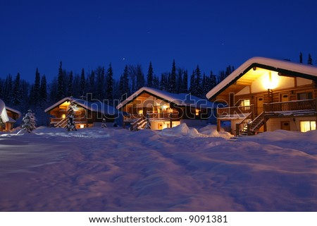 Winter Chalet's in Twilight - stock photo