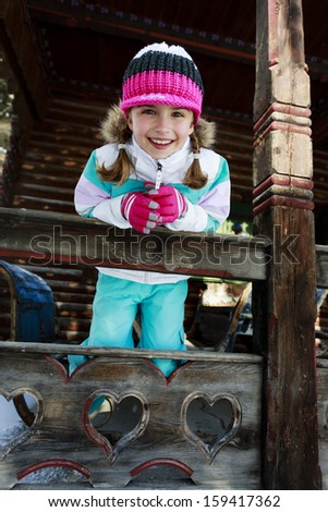 Winter, child, apres ski - young girl enjoying winter vacation - stock photo