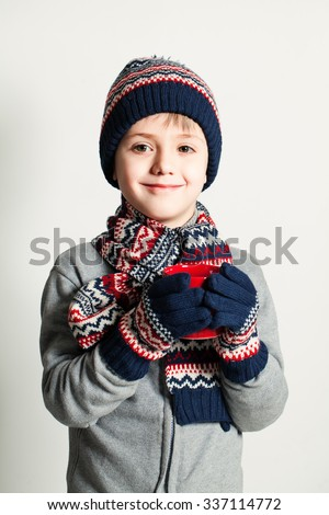 Winter Child Boy drink Tea or Coffee. Winter Clothes. Sweater, Hat and Scarf - stock photo
