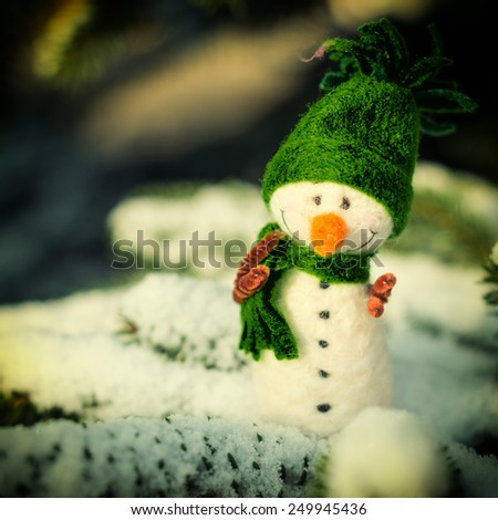 Winter, Christmas - Happy, smiling vintage snowman on snow (copy space) - stock photo
