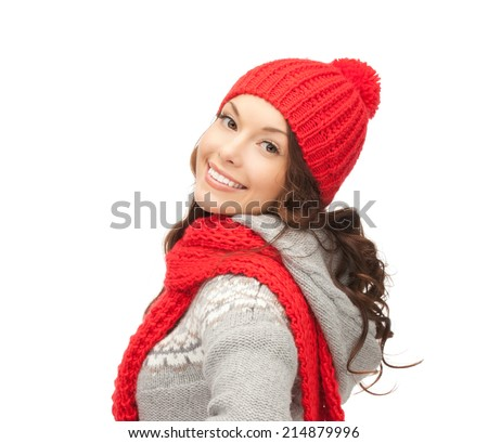 winter, christmas, holidays, clothing and people concept - smiling asian woman in red hat and mittens over white background - stock photo