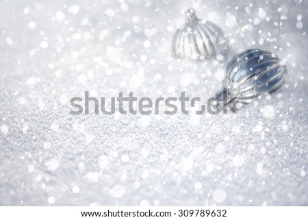 Winter Christmas snow background with baubles. - stock photo