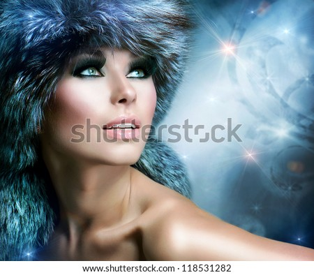 Winter Christmas Woman Portrait. Beautiful Model Girl. Fur Fashion. Beautiful Girl in Fur Hat. - stock photo