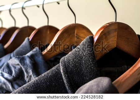 Winter clothes hanged on a clothes rack  - stock photo